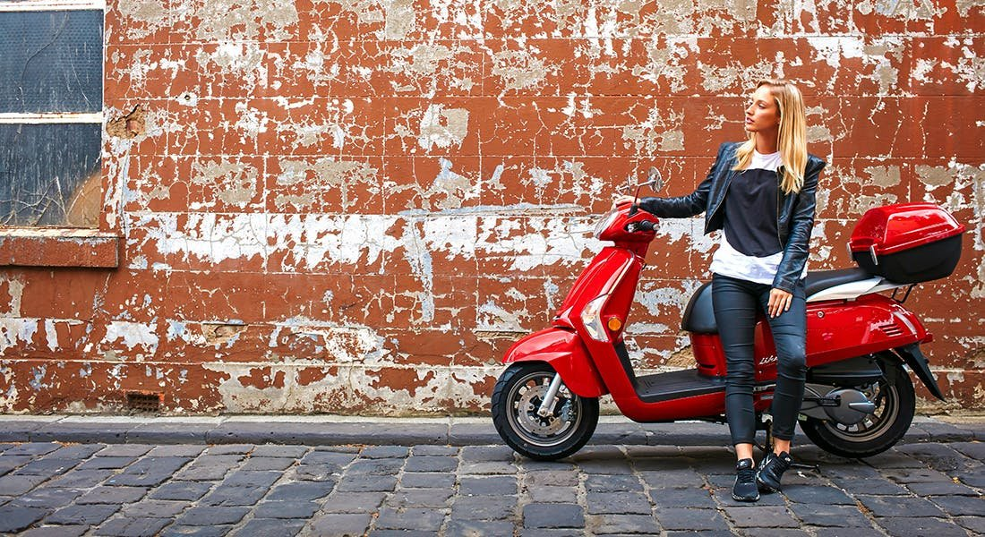 KYMCO LIKE 125 in red colour, parked