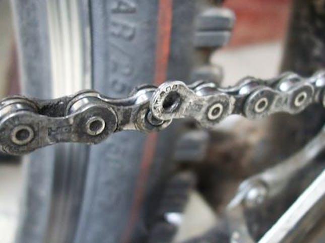 A half broken bike chain link
