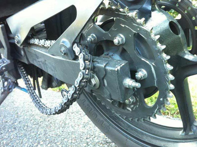 A motorcycle chain off the sprocket