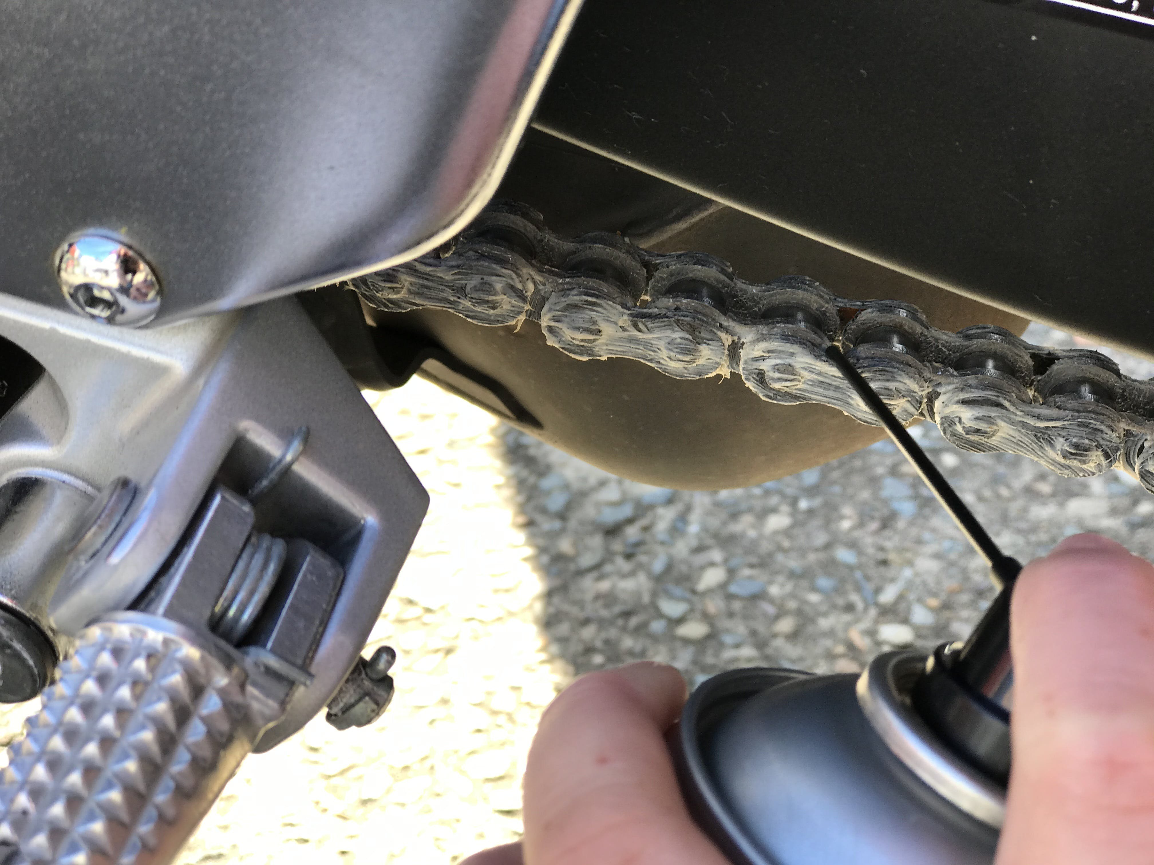 Straw on chain lube chain can being used on a motorcycle